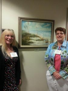 AnnaJo Sells A Giclee At The Gray Robinson Art Reception In Viera